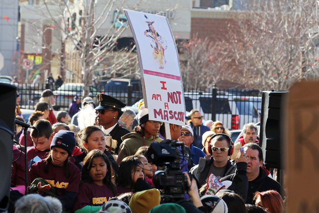 Nov 2, 2014; Minneapolis, MN, USA; A detailed view of a sign during a protest against Washington Redskins name and imagery prior to a game against the Minnesota Vikings at TCF Bank Stadium. (Brace ...