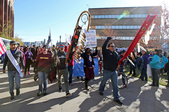 Nov 2, 2014; Minneapolis, MN, USA; Members of the National Coalition Against Racism protest the Washington Redskins name and imagery prior to a game against the Minnesota Vikings at TCF Bank Stadi ...