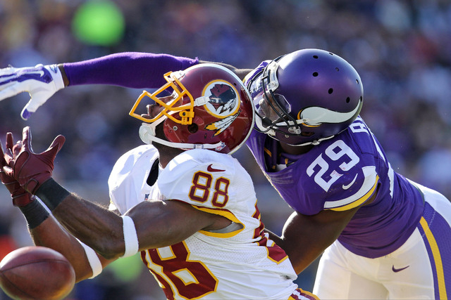 Nov 2, 2014; Minneapolis, MN, USA; Minnesota Vikings cornerback Xavier Rhodes (29) breaks up a pass intended for Washington Redskins wide receiver Pierre Garcon (88) during the second quarter at T ...