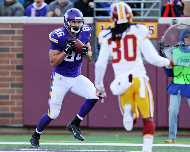 Nov 2, 2014; Minneapolis, MN, USA; Minnesota Vikings tight end Chase Ford (86) catches a touchdown pass during the second quarter against the Washington Redskins at TCF Bank Stadium. (Brace Hemmel ...