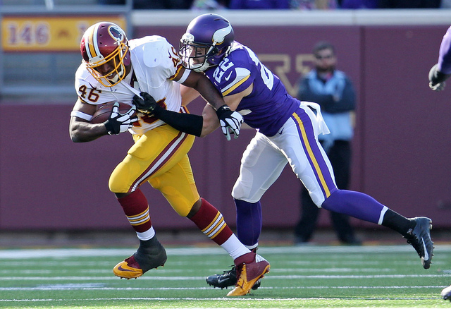 Nov 2, 2014; Minneapolis, MN, USA; Washington Redskins running back Alfred Morris (46) is tackled by Minnesota Vikings safety Harrison Smith (22) during the second quarter at TCF Bank Stadium. (Br ...