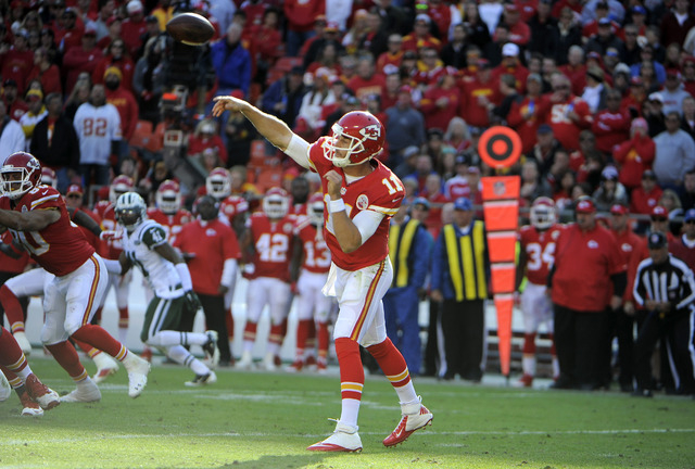 Nov 2, 2014; Kansas City, MO, USA; Kansas City Chiefs quarterback Alex Smith (11) throws a pass against the New York Jets in the second half at Arrowhead Stadium. Kansas City won the game 24-10. ( ...