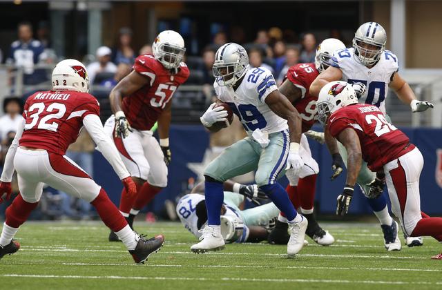 Nov 2, 2014; Arlington, TX, USA; Dallas Cowboys running back DeMarco Murray (29) runs the ball against  Arizona Cardinals free safety Tyrann Mathieu (32) and free safety Rashad Johnson (26) in the ...