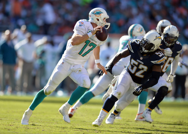 Nov 2, 2014; Miami Gardens, FL, USA; Miami Dolphins quarterback Ryan Tannehill (17) runs with the ball as San Diego Chargers outside linebacker Reggie Walker (52) chases during the second half at  ...