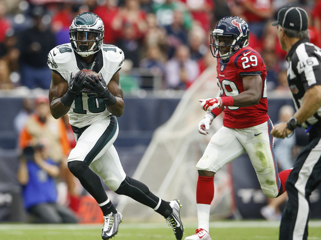 Nov 2, 2014; Houston, TX, USA; Philadelphia Eagles wide receiver Jeremy Maclin (18) scores a touchdown past Houston Texans defensive back Andre Hal (29) during the game at NRG Stadium. (Kevin Jair ...