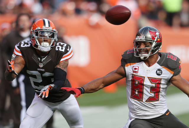 Nov 2, 2014; Cleveland, OH, USA; Cleveland Browns cornerback Joe Haden (23) breaks up a pass intended for Tampa Bay Buccaneers wide receiver Vincent Jackson (83) during the first quarter at FirstE ...
