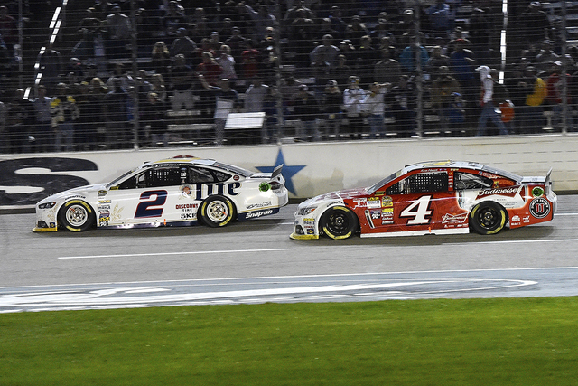 Nov 2, 2014; Fort Worth, TX, USA; NASCAR Sprint Cup Series driver Brad Keselowski (2) and NASCAR Sprint Cup Series driver Kevin Harvick (4) race during the AAA Texas 500 at Texas Motor Speedway. ( ...