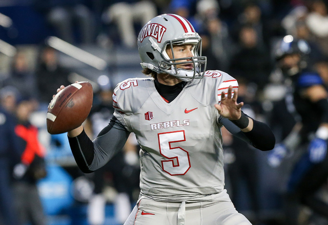 Nov 15, 2014; Provo, UT, USA; UNLV Rebels quarterback Blake Decker (5) looks to throw the ball against the Brigham Young Cougars during the first quarter at Lavell Edwards Stadium. Mandatory Credi ...
