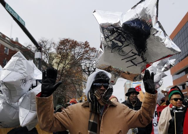 Demonstrators march through the streets during a protest over the shooting death of Michael Brown in Clayton, Missouri, November 17, 2014. Several dozen demonstrators took to the streets Monday in ...