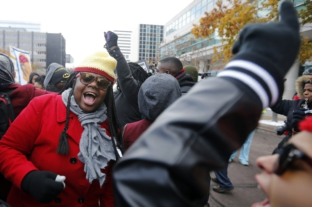 Demonstrators take part in a protest in front of the building where the grand jury is looking into the shooting death of Michael Brown in Clayton, Missouri, November 17, 2014. Several dozen demons ...