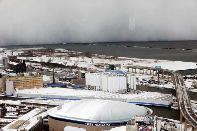 A lake-effect snow storm with freezing temperatures produces a wall of snow traveling over Lake Erie into Buffalo, New York. (Reuters/Gary Wiepert)