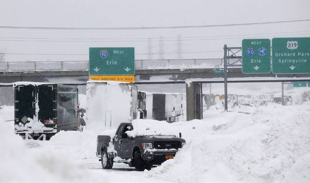 Vehicles litter the highway in West Seneca, New York November 19, 2014. An autumn blizzard dumped a year's worth of snow on western New York state where five people died and residents, some strand ...