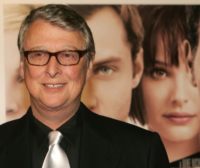 """Director Mike Nichols poses next to a poster for his film """"Closer"""" as he arrives for the film's premiere in Los Angeles on Nov. 22, 2004. Nichols died Wednesday, Nov. 19, 2014, at 83. (Reuters/Fre ..."""