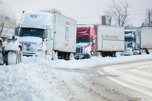 Trucks sit stranded on a closed New York State Thruway in the town of Cheektowaga near Buffalo, New York, November 20, 2014. (REUTERS/Lindsay DeDario)