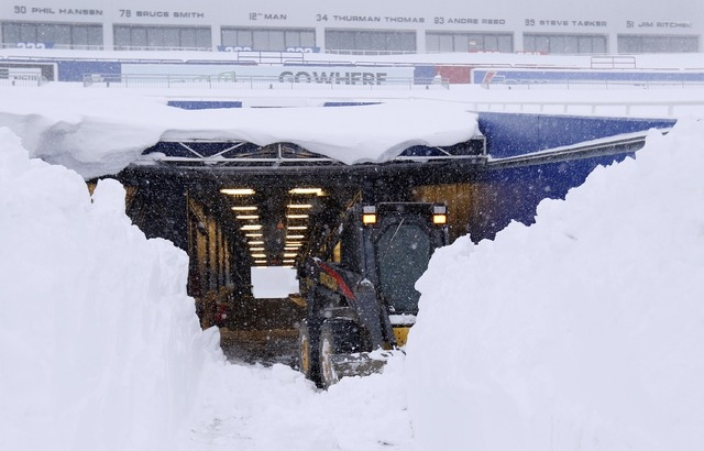 Nov 20, 2014; Orchard Park, NY, USA; After a major snow storm a grounds crew worker begins to clear snow from the football field at Ralph Wilson Stadium. (Kevin Hoffman-USA TODAY Sports)