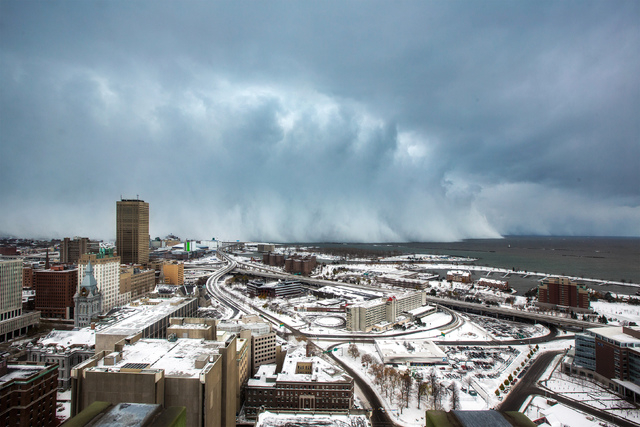Storm clouds and snow blow off Lake Erie in Buffalo, New York, November 18, 2014. (REUTERS/Lindsay DeDario)