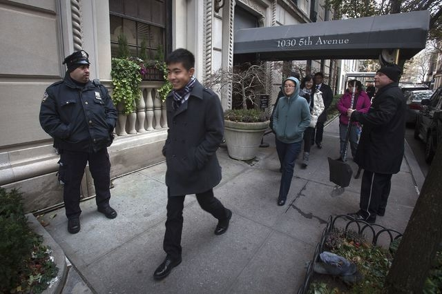 A police officer stands outside the building where director Mike Nichols resided in New York, Nov. 20, 2014. Nichols, a nine-time Tony Award winner on Broadway and the Oscar-winning director of fi ...