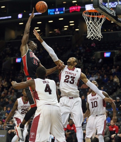 UNLV Runnin' Rebels forward Goodluck Okonoboh (11) shoots over Temple Owls forward Devontae Watson (23) during the second half at Barclays Center. UNLV defeated Temple 57-50. (Brad Penner/USA TODA ...