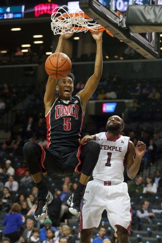 UNLV Runnin' Rebels forward Christian Wood (5) dunks over Temple Owls guard Josh Brown (1) during the second half at Barclays Center. UNLV defeated Temple 57-50. (Brad Penner/USA TODAY Sports)