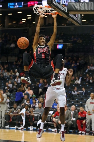 UNLV Runnin' Rebels forward Christian Wood (5) dunks over Temple Owls guard Josh Brown (1) during the second half at Barclays Center in Brooklyn, N.Y. UNLV defeated Temple 57-50. (Brad Penner/USA  ...
