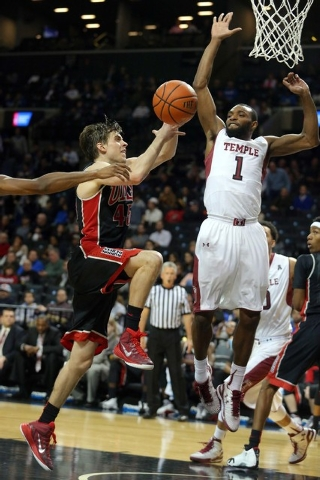 UNLV Runnin' Rebels guard Cody Doolin (45) drives on Temple Owls guard Josh Brown (1) during the second half at Barclays Center. UNLV defeated Temple 57-50. (Brad Penner/USA TODAY Sports)