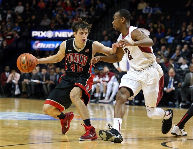 UNLV Runnin' Rebels guard Cody Doolin (45) controls the ball against Temple Owls guard Will Cummings (2) during the second half at Barclays Center. UNLV defeated Temple 57-50. (Brad Penner/USA TOD ...