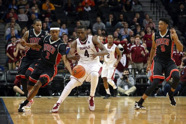 UNLV Runnin' Rebels guard Patrick McCaw (2) steals the ball from Temple Owls guard Daniel Dingle (4) during the second half at Barclays Center. UNLV defeated Temple 57-50. (Brad Penner/USA TODAY S ...