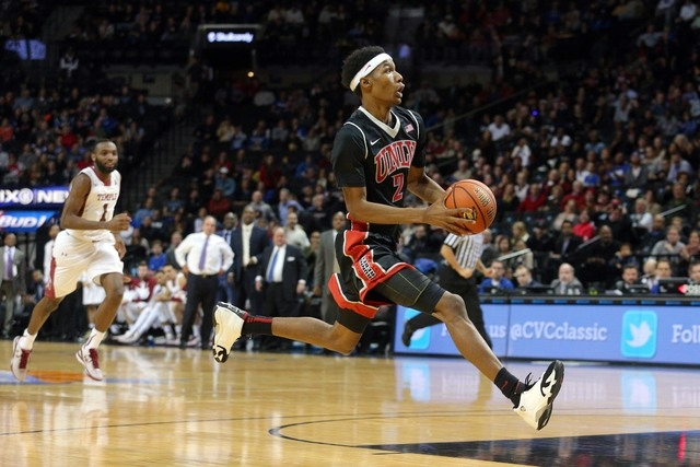 UNLV Runnin' Rebels guard Patrick McCaw (2) drives to the basket against the Temple Owls during the second half at Barclays Center. UNLV defeated Temple 57-50. (Brad Penner/USA TODAY Sports)
