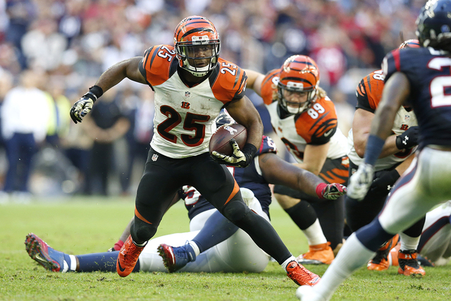 Nov 23, 2014; Houston, TX, USA; Cincinnati Bengals running back Giovani Bernard (25) runs with the ball against the Houston Texans at NRG Stadium. (Matthew Emmons-USA TODAY Sports)