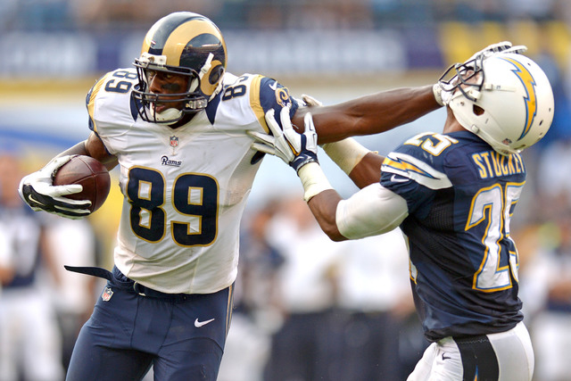 St. Louis Rams wide receiver Kenny Britt (81) stiff arms San Diego Chargers defensive back Darrell Stuckey (25) during the fourth quarter after making a catch at Qualcomm Stadium, Sunday, Nov 23,  ...