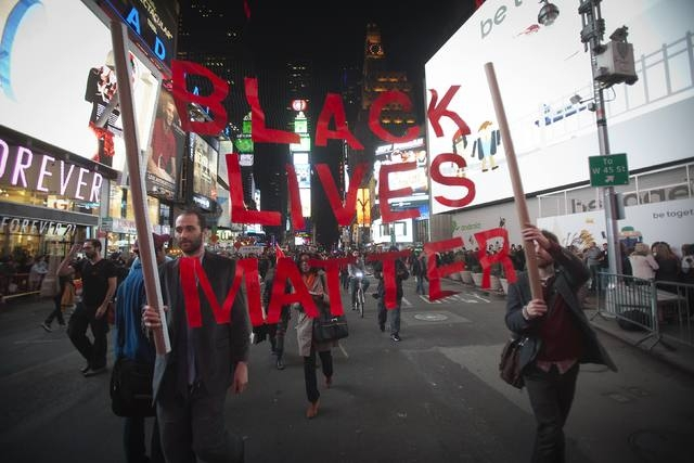 Protesters demonstrate in Times Square after the grand jury's decision to not indite Ferguson police officer Darren Wilson in the shooting death of unarmed 18-year-old Michael Brown was announced, ...