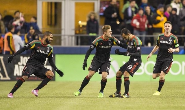 Los Angeles Galaxy midfielder Juninho (19) celebrates with his teammates after he scored against the Seattle Sounders FC during the second half of the Western Conference Championship at CenturyLin ...
