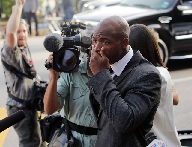 Minnesota Vikings running back Adrian Peterson arrives at court in Conroe, Texas, Wednesday, Oct. 8, 2014. A judge tentatively set a Dec. 1 trial date for Peterson on a charge of felony child abus ...