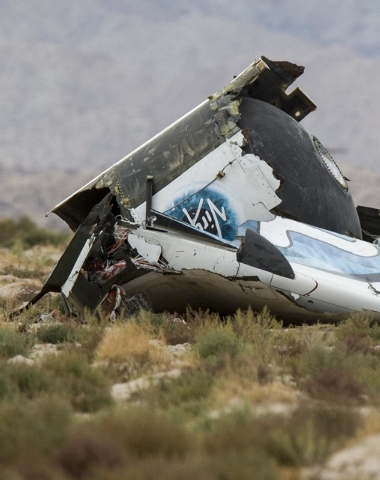Wreckage lies near the site where a Virgin Galactic space tourism rocket, SpaceShipTwo, exploded and crashed in Mojave, Calif.  Friday, Oct. 31, 2014.  The explosion killed a pilot aboard and seri ...
