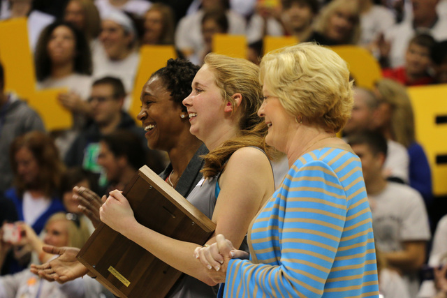 Mount St. Joseph's Lauren Hill stands with Patt Summit, right, and WNBA Player Tamika Devonne Catchings, of the Indiana Fever, left, after recieving the Pat Summitt Award during halftime of her fi ...