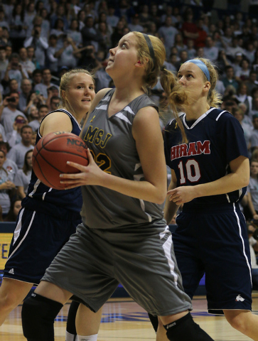 Mount St. Joseph's Lauren Hill shoots a lay up during her first NCAA college basketball game against Hiram University at Xavier University in Cincinnati on Sunday Nov 2, 2014. The NCAA allowed Mou ...