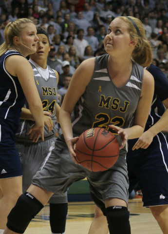 Mount St. Joseph's Lauren Hill catches a pass and prepares to shoot during her first NCAA college basketball game against Hiram University at Xavier University in Cincinnati on Sunday Nov 2, 2014. ...