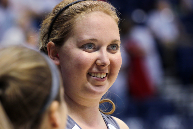 Mount St. Joseph's Lauren Hill laughs with a teammate at before her first NCAA college basketball game against Hiram University at Xavier University in Cincinnati on Sunday, Nov 2, 2014. The NCAA  ...