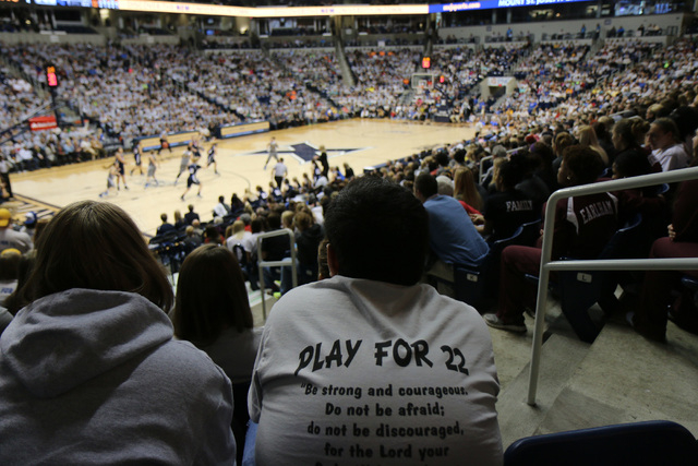 A Mount St. Joseph's fan wears a tshirt for Lauren Hill during her first NCAA college basketball game against Hiram University at Xavier University in Cincinnati on Sunday Nov 2, 2014. The NCAA al ...