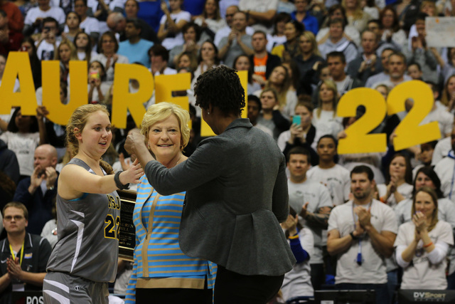 Mount St. Joseph's Lauren Hill hugs Patt Summit, center, and WNBA Player Tamika Devonne Catchings, of the Indiana Fever, right, after recieving the Pat Summitt Award during halftime of her first N ...