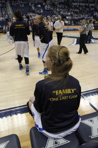 Mount St. Joseph's Lauren Hill takes a break as her team warms up before her first NCAA college basketball game against Hiram University at Xavier University in Cincinnati on Sunday Nov 2, 2014. T ...