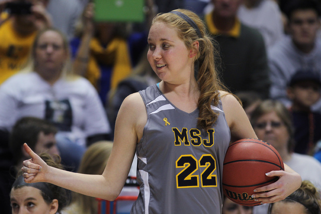 Mount St. Joseph's Lauren Hill gives thumbs up as she holds the game ball during her first NCAA college basketball game against Hiram University at Xavier University in Cincinnati, Sunday Nov 2, 2 ...