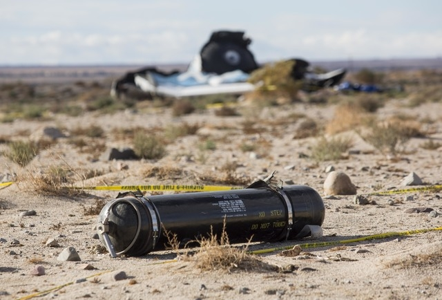 A tank, part of wreckage lies near the site where a Virgin Galactic space tourism rocket, SpaceShipTwo, exploded and crashed in Mojave, Calif. Saturday, Nov 1, 2014. The explosion killed a pilot a ...