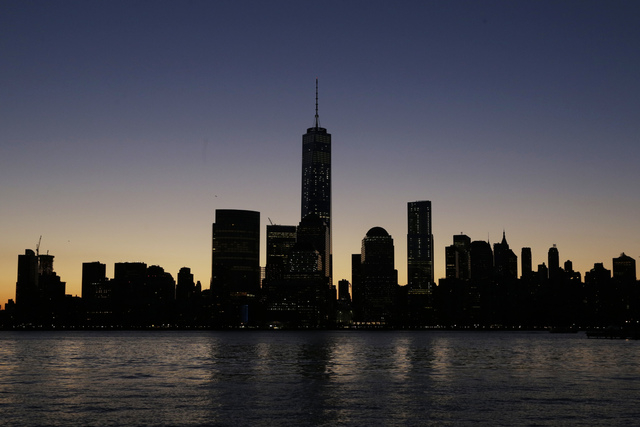 One World Trade Center, center, dominates the lower Manhattan skyline, Monday, Nov. 3, 2014 in this view from Jersey City, N.J. Thirteen years after the 9/11 terrorist attack, the resurrected Worl ...
