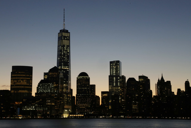 One World Trade Center dominates the lower Manhattan skyline, Monday, Nov. 3, 2014 in this view from Jersey City, N.J. Thirteen years after the 9/11 terrorist attack, the resurrected World Trade C ...