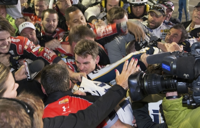 Jeff Gordon is in the middle of a fight after the NASCAR Sprint Cup Series auto race at Texas Motor Speedway in Fort Worth, Texas, Sunday, Nov. 2, 2014.  The crews of  Gordon and Brad Keselowski f ...