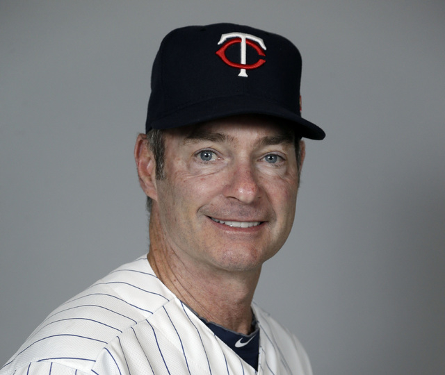 This is a 2014 photo of coach Paul Molitor of the Minnesota Twins baseball team. The Twins say, Monday, Nov. 3, 2014,  they will hire Molitor as manager after four straight seasons of 92 or more l ...