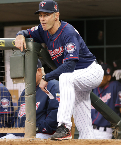 In this May 27, 2014, file photo, Minnesota Twins coach Paul Molitor watches in the fourth inning of a baseball game against the Texas Rangers in Minneapolis. The Twins say, Monday, Nov. 3, 2014,  ...
