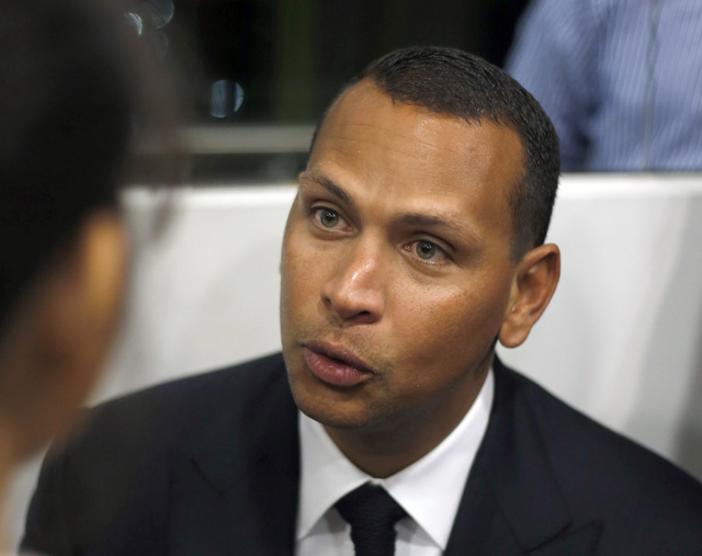 In this Jan. 16, 2014, file photo, Alex Rodriguez speaks during a news conference in Cancun, Mexico. The U.S. government says New York Yankees star Alex Rodriguez paid his cousin almost $1 million ...