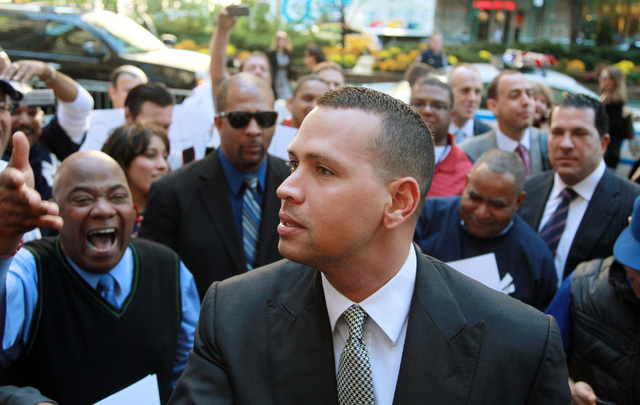In this Oct. 1, 2013, file photo, New York Yankees' Alex Rodriguez arrives at the offices of Major League Baseball in New York. (AP Photo/David Karp, File)